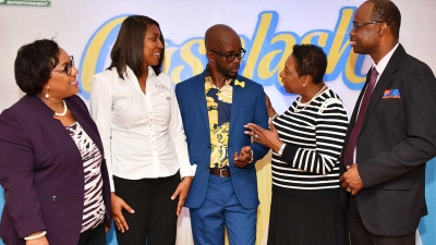 The Honourable Olivia Grange, Minister of Culture, Gender, Entertainment and Sport in conversation with Markland Edwards, CEO Action Entertainment (third left). Also photographed are: Rosalee Gage-Grey, CEO, Child Protection and Family Services Agency; Kerine Hamilton, CEO, Auto Channel and Alfred McDonald, Senior Director, Commercial Development and Planning, Norman Manley International Airport (left to right). Occasion was the launch of Auto Channel Gospalsh 2018 at the Liguanea Golf Club in New Kingston.