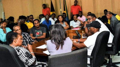 The Minister of Culture, Gender, Entertainment and Sport, the Honourable Olivia Grange (left) in discussion with stakeholders in the entertainment industry at her offices in New Kingston on 9 September 2019.