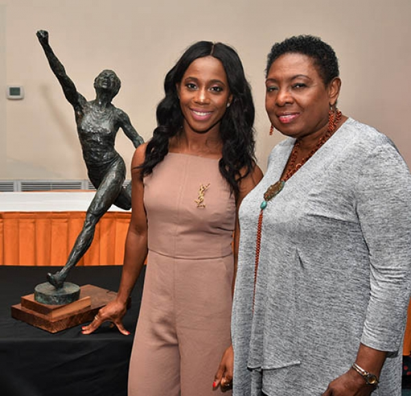 The Honourable Olivia Grange, Minister of Culture, Gender, Entertainment and Sport with Olympian Shelly-Ann Fraser-Pryce, following the unveiling of the maquette of the statue that will be mounted in her honour at Statue Park in October.