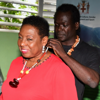 The Honourable Olivia Grange, Minister of Culture, Gender, Entertainment and Sport is photographed with Oral 'Briggy' White, one of the entrepreneurs who attended the Economic Opportunities Workshop in Accompong, St. Elizabeth.