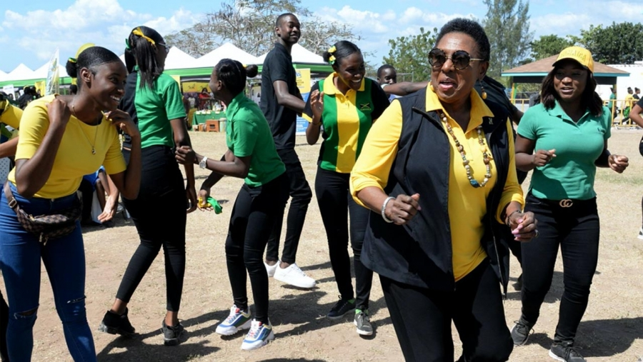 The Minister of Culture, Gender, Entertainment and Sport, the Honourable Olivia Grange participating in Jamaica Day activities at the Denbigh High School in Clarendon,