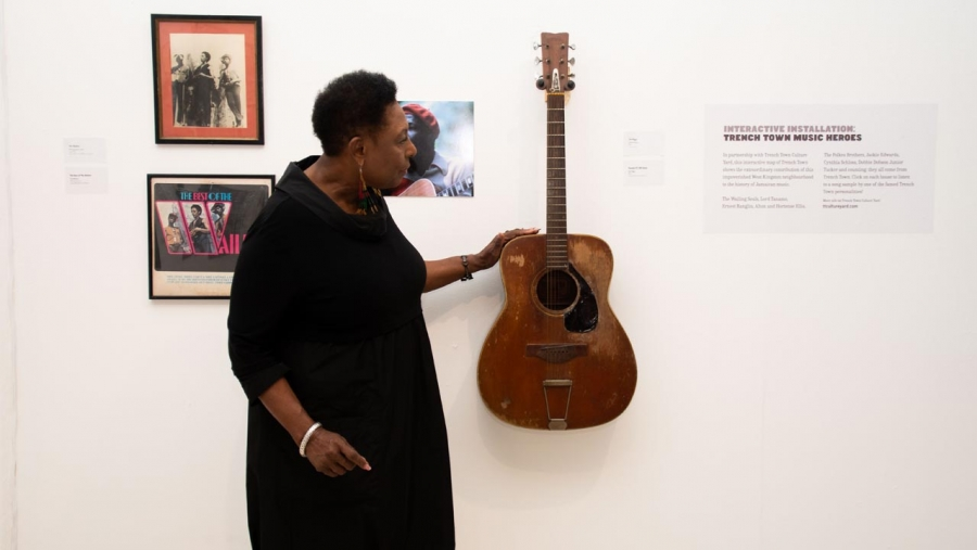 The Minister of Culture, Gender, Entertainment and Sport, the Honourable Olivia Grange, admires a guitar of the late Reggae musician Joe Higgs, which is part of the Jamaica Jamaica! exhibition now on show at the National Gallery of Jamaica until the end of June.  Minister Grange launched the exhibition as a major activity for Reggae Month.