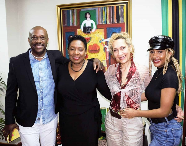 Reggae Artiste J.C. Lodge (second right); husband Errol O'Meally (left) and daughter Gia paid a Courtesy Call on the Honourable Olivia Grange, Minister of Culture, Entertainment, Gender and Sport on Tuesday at her offices in Kingston.  JC Lodge, who is well known for her hit songs 'Telephone Love' and 'Someone Loves You Honey', is in Jamaica to perform at Rebel Salute this Friday night at Grizzlys Plantation Cove in St Ann.
