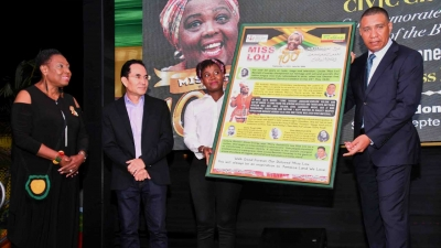 Prime Minister, the Most Honourable Andrew Holness (right), receives a Miss Lou Storyboard from Mrs. Nicole Watson-Chang, Manager of Fontana Pharmacy.  Sharing the moment are the Minister of Culture, Gender, Entertainment and Sport, the Honourable Olivia Grange (left) and Director of Fontana Limited, Kevin Obrien Chang (2nd left). In celebration of Miss Lou 100, Fontana Pharmacy has collaborated with the Ministry of Culture, Gender, Entertainment and Sport to produce over 1,700 Miss Lou Storyboards for schools, ministries, and embassies.