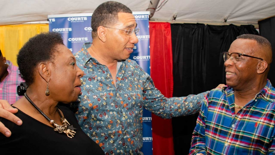Prime Minister, the Most Honourable Andrew Holness (centre) shares a light moment with the Minister of Culture, Gender, Entertainment and Sport, the Honourable Olivia Grange (left) and veteran broadcaster, Barry G (right) at Rebel Salute 2020