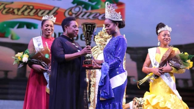 The Minister of Culture, Gender, Entertainment and Sport, the Honourable Olivia Grange, presents winning trophy to Miss Jamaica Festival Queen 2019, Khamara Wright.  Also pictured are 1st Runner Up AnnaKay Hudson (left) and 2nd Runner Up Chardonnae Parkins.