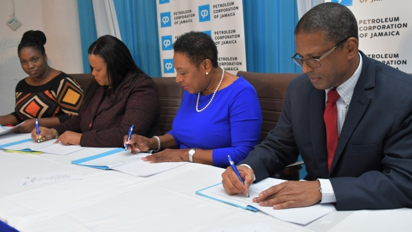 The Honourable Oliva Grange, Minister of Culture, Gender, Entertainment and Sport (second right); Robert Clarke, Group General Manager (Acting), Petroleum Corporation of Jamaica (right); Daffodil Thompson, Interim Executive Director, Jamaica Cultural Development Commission (second left) and Jody Grizzle, Project Manager, Energy Efficiency and Conservation Programme sign a Memorandum of Understanding. The MOU was signed between the the Petroleum Corporation of Jamaica and the Jamaica Cultural Development Commission, an agency of the Ministry of Culture, Gender, Entertainment and Sport.