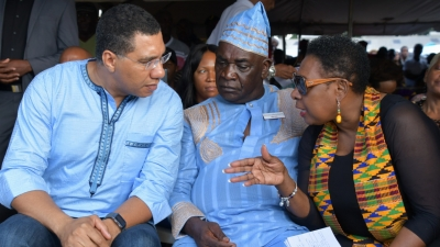 Minister of Culture, Gender, Entertainment and Sport, the Honourable Olivia Grange (right) in conversation with Prime Minister, the Most Honpourable Andrew Holness (left) and Colonel Ferron Williams of the Accompong Maroons at the celebration of the 281st signing of the Treaty with the British and the birthday of Captain Kojo in Accompong Town, St Elizabeth on Sunday, January 6.