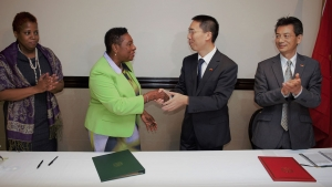 A handshake to seal the deal. The Honourable Olivia Grange, Minister of Culture, Gender, Entertainment and Sport and His Excellency, Niu Qingbao, Ambassador of the People's Republic of China to Jamaica signed a Letter of Exchange sealing a technical cooperation project on sports which will see the provision of Chinese coaches for seven sporting disciplines in Jamaica. Supporting the Minister is Dr. Janice Lindsay, Acting Permanent Secretary in the Ministry (left), while Fan Jianghong, Counsellor, Economic and Commercial Counsellor Office, People's Republic of China Embassy accompanied the Ambassador (right). The signing took place at the Jamaica Pegasus.