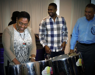 Showing off her skills, the Honourable Olivia Grange, Minister of Culture, Gender, Entertainment and Sport was 'guest steel pan player' following her presentation at the Media Launch of Carnival in Jamaica 2018 at the Jamaica Pegasus on Thursday, October 19. Enjoying the 'session' are: Kamal Bankay, Chairman, Sports and Entertainment Network and Donnie Dawson, Acting Director Tourism, Jamaica Tourist Board.