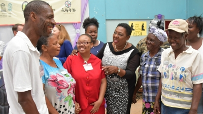 The Minister of Culture, Gender, Entertainment and Sport, the Honourable Olivia Grange (centre) in conversation with participants of the workshop on intangible cultural heritage being held at the Trench Town Multipurpose Centre.