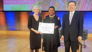 Minister of Culture, Gender, Entertainment and Sport, the Honourable Olivia Grange (centre) accepts the UNESCO Prize for Girls' and Women's Education on behalf of the Women's Centre of Jamaica Foundation from UNESCO Assistant Director-General for Education, Stefania Giannini, on Thursday (11 October 2018).  Also pictured is Vice Minister of Education of China and Chair of the Chinese Commission for UNESCO, Tian Xuejun.  The prize is sponsored by the People's Republic of China.